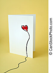 red heart in a postcard