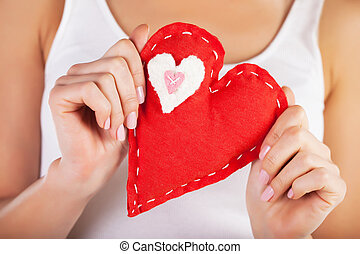 Red heart in hands