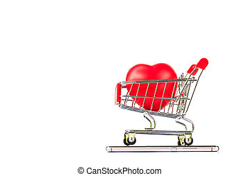 Red heart in shopping cart on smartphone on white background