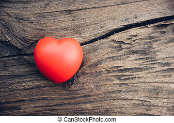 Red heart love on wooden background