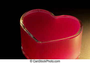 red heart made of glass. vertical image