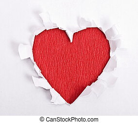 Red heart of the torn paper