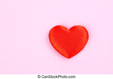 red heart on a pink background