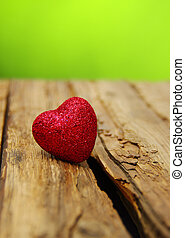 Red heart on a wood