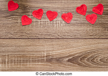 red heart on a wooden background