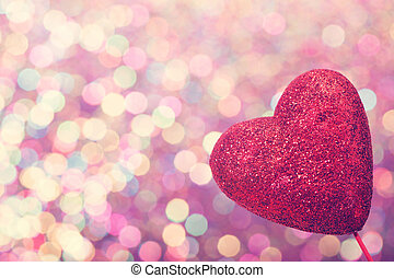 Red heart on abstract shiny light background