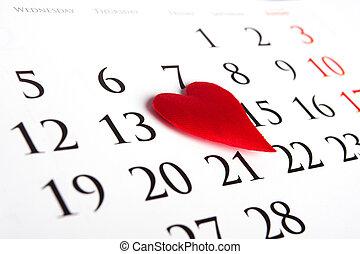 Red heart on calendar