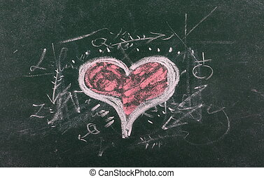Red heart on chalkboard, blackboard texture