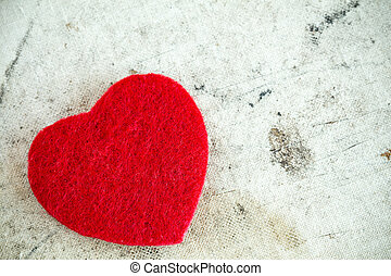 Red heart on dirty background