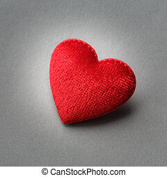 Red heart on gray background