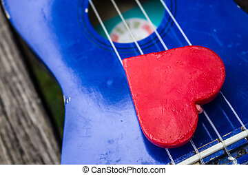 Red heart on guitar.