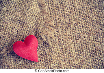 Red heart on gunny sackcloth texture