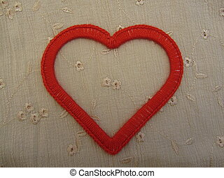 Red heart on natural linen texture