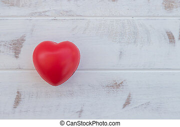 Red heart on old vintage white wood