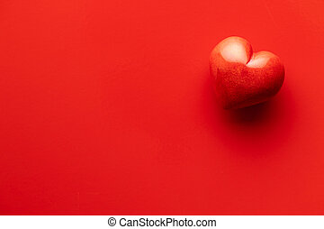 Red heart on red background.