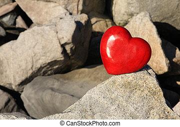 Red heart on rocks