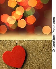 Red heart on the edge of a wooden table