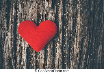 red heart on the wood texture