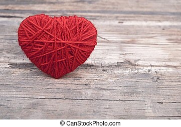 red heart on the wooden background