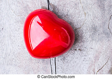 Red heart on the wooden