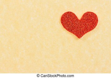 red heart on vintage parchment paper background