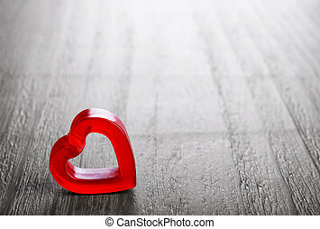 Valentines Day symbol - red heart on vintage wooden...