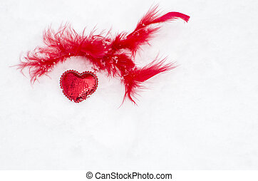 red heart on white snow