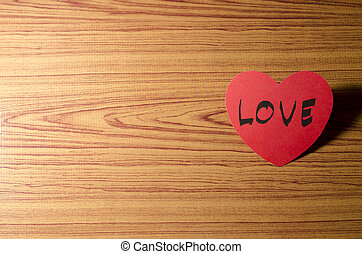 red heart on wood background