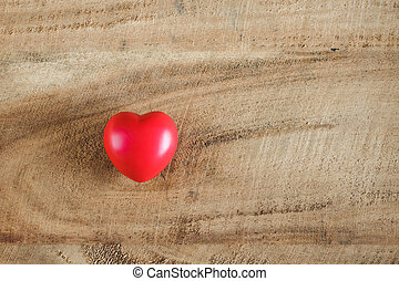 Red heart on Wood texture background.