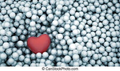 Red heart shape falling into glossy balls - Red heart shape...