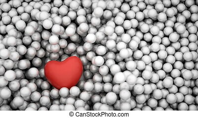 Red heart shape falling into glossy balls. Slow motion. 3D...