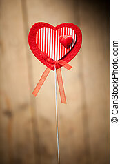 red heart shape on brown wooden background