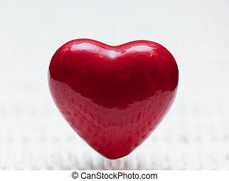 Red heart shape on wicker. Symbol of love