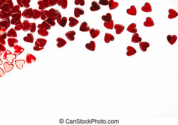 Red heart shaped confetti isolated on white background