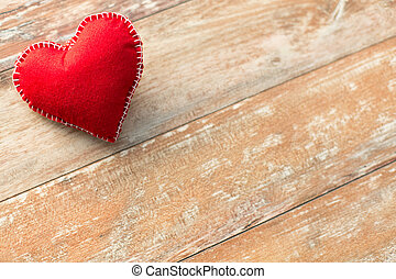 red heart shaped decoration on wooden background