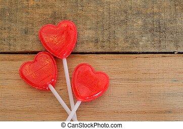 Red heart shaped lollipop on pallet