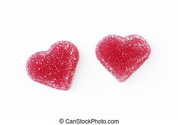 Red heart-shaped marmalade isolated on a white background. Concept valentine's day food, love. Copy space