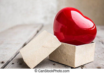 Red heart symbol in the box