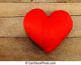 red heart symbol on the wooden background