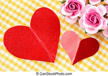 Red heart tag paper and pink rose flower.