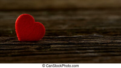 Red heart tuck in the wooden plank 4k - Red heart tuck in ...