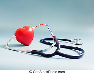 red heart using deep blue stethoscope on the blue background. Concept of love and caring patient by the heart. Copy space for the text and contents
