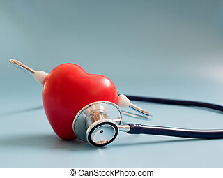 red heart using deep blue stethoscope on the blue background for hear their own heart. Concept of love and caring patient by the heart. Copy space for the text and contents