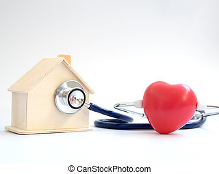 red heart using stethoscope on the blue background for house health check. Concept of love and caring patient house by the heart. Copy space for the text and contents