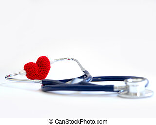 red heart using stethoscope on the white background (Isolated background). Concept of love and caring patient by the heart. Copy space for the text and contents