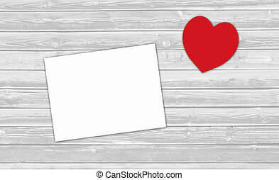 Red heart Valentine's day and paper sheet on wooden background