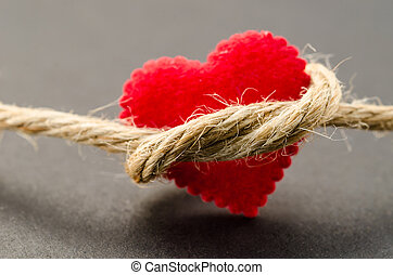 Red heart with a bundle rope. - Red heart with a bundle rope...