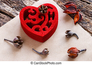 red heart with a pattern on a wooden background