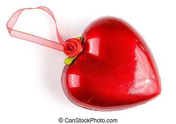 red heart with a ribbon for hanging isolated on white background