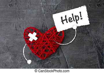 Red heart with a sign asking for help. Theme of medicine, health. Copy space